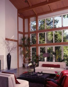 "Amazing ""wall of windows' in our Contemporary Barn. Click thru to check out the house and view floor palns! #timberframe #barnhome"