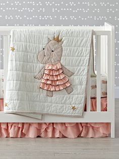 Shop Royal Hippo Baby Quilt. The regal hippo on this charming crib quilt don't require you to bow or curtsy. She just asks that you add them to any nursery for a fun, playful touch.