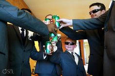 The men sharing a toast before a destination wedding at Beach Palace Resort in Cancun (that would be a soda pop for the wee one of course). @prweddings Mexico wedding photographers Del Sol Photography.
