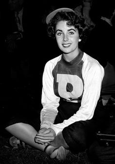 """Elizabeth Taylor as a Bat Girl, 1949, Hollywood, California Notes from John R. Hamilton:  """"I was photographing a Hollywood Stars charity baseball game when Elizabeth Taylor made an appearance as one of the bat girls.  I went nuts.  She looked to be about sixteen years old.  I was so close to her!  What excitement!  Her beauty was present even in a plain baseball uniform.  My eyes were riveted on her during that baseball game.  I guess you would have to say that I had a bad case of puppy…"""