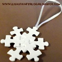 I have never thought of using puzzle pieces for anything other than… puzzles. Lisa at Lisa's Craft Blog whipped up a couple of lovely ornaments using little parts of a 1000 piece puzzl...