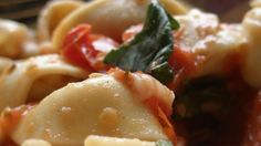 Sweet cherry tomatoes are roasted with olive oil, quickly made into a sauce, and served with prepared tortellini for an Italian-inspired dish that's fast and fresh.