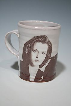Dana Scully is a goddess. Look at her face as you drink your coffee each day.
