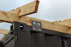 Shipping Container Cabin & Observatory: Roof attachment to container