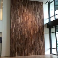 3D Walnut Wall in commercial lobby by Woodwright Floors