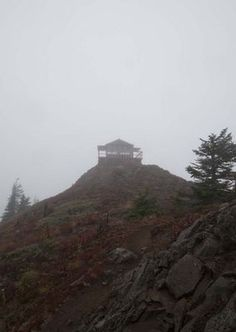 A fire lookout is shrouded in fog in the Mount Baker-Snoqualmie National Forest