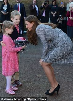 The Duchess of Cambridge made two youngsters happy when she accepted their bouquet of flowers after she visited a charity she supports. February 19, 2013