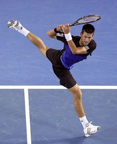 Novak Djokovic proves guys are flexible...      Is this an optical illusion?