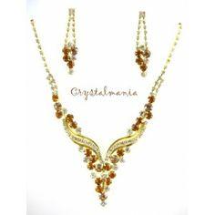 Set de collar y aretes con cristal en tono dorado y topas estilo 4031