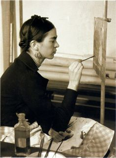 """Frida Kahlo painting a self-portrait"" Frida Kahlo de Rivera (6 July 1907—13 July 1954) was born Magdalena Carmen Frieda Kahlo y Calderón. She was a Mexican painter, born in Coyoacán, and is perhaps best known for her self-portraits. Photographer unknown."