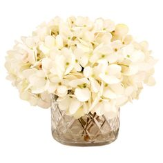 Add a charming centerpiece to your desk or coffee table with this beautiful faux hydrangea arrangement, showcasing lush blooms nestled in a textured glass va...