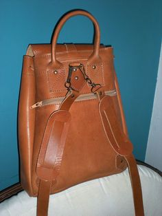 Handmade & Durable Leather Backpack-Shoulder Bag in tobacco brown with Lace. €61.00, via Etsy.