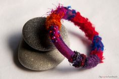 handmade bracelet with felt, silk, fancy yarns and beads