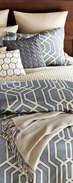 layering geometric pattern, transitional bedding, grey and white. DesignNashville, custom bedding in the color and style just right for you