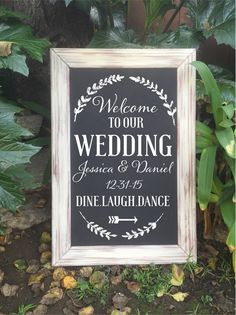 Framed chalk art welcome wedding sign This sign is made from wood. It is painted with chalkboard paint then hand painted with white paint. The