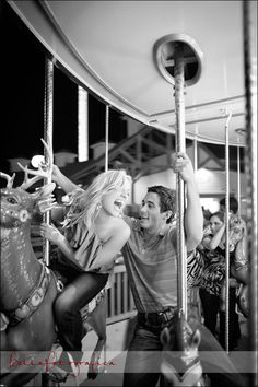 engaged couple riding carousel at kemah