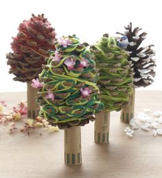 "Yarn ""needles"" decorate these pretty pinecone and coin roll trees. Try this simple #craft on the next rainy day."