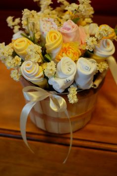 Baby shower bouquet using onsies and washcloths - cute idea for the not so talented diaper cake makers like me! by leta Baby Shower Bouquet, Diaper Bouquet, Baby Bouquet, Baby Shower Crafts, Baby Crafts, Shower Gifts, Baby Shower Decorations, Baby Washcloth, Shower Bebe