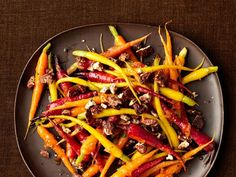 Get Food Network Kitchen's Marmalade-Glazed Carrots With Candied Pecans Recipe from Food Network