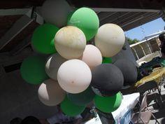green white black balloons