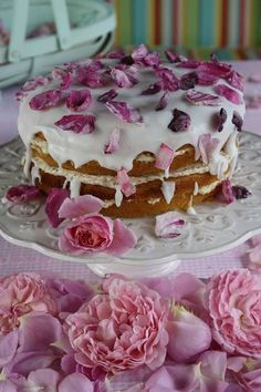 Crystallized rose petals are a romantic and beautiful topping for a wedding cake - perfect for a Pre-Raphaelite themed wedding.