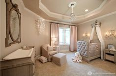 The crown above the cot in this nursery by interior firm, A Well Dressed Home, adds royal charm