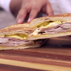 Delicious layers of citrus marinated pork roast, ham, cheese, and pickles, all in toasty bread, make this classic sandwich unforgettable.