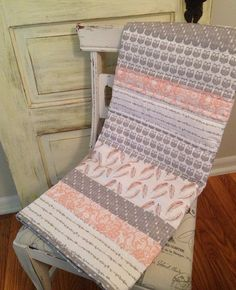A study of Owls, nice collaboration of fabrics. Coral and Grey Owl Baby Quilt by Nooches on Etsy, $145.00