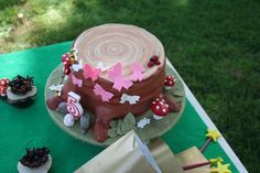Woodland tree stump birthday cake. I'd need to stick something pink on top for Maddie, like a butterfly.