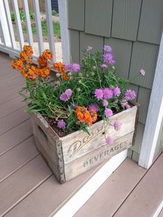 Wooden box planter w/ cut out handles. May put wheels on it because once filled with dirt, this will be heavy!