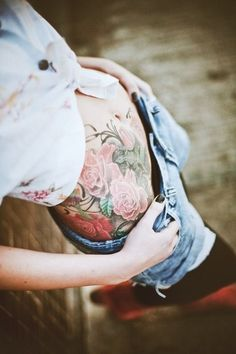 Stomach tattoo. Rose.