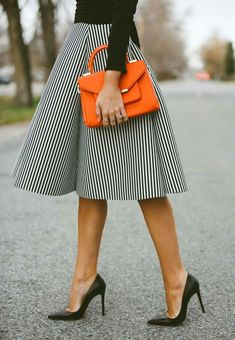 Full skirt, black shirt, orange purse, black heels, what to wear to work