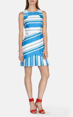 Panneled shift dress with pleated front skirt