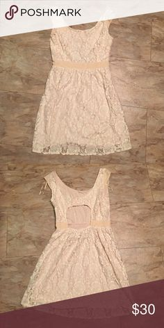 Lace cream dress from American Eagle. This is a lace cream dress from American Eagle. It is an hole cut out in the back and it very pretty on. Size 10. American Eagle Outfitters Dresses