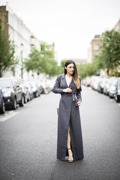 Anisa Sojka wearing grey Motif Official belted tailored maxi dress, mirror Skinny Dip London boxy bag and black Little Mistress sandal heels with ostrich feathers. Fashion blogger street style shot in London by Cristiana Malcica.