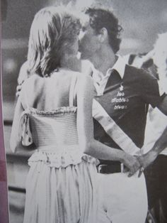 July 12, 1983: Prince Charles and Princess Diana share a tender moment at a polo match.
