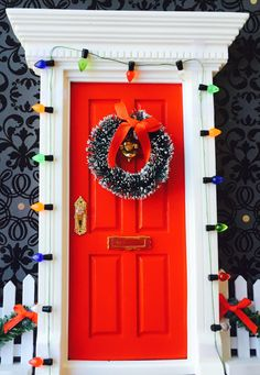Red Christmas Fairy Door With Wreath & Lights by FairyAvenue on Etsy https://www.etsy.com/listing/212468583/red-christmas-fairy-door-with-wreath