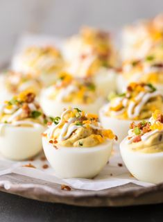DEVILED EGG RECIPE LOADED just like a Loaded Baked Potato! Smothered in a mixture of cheese, bacon, sour cream, chives, and more! This is the BEST Deviled Eggs Recipe perfect for Easter, Christmas, or any day in between. The ultimate holiday Easy Deviled Eggs. Snack Mix Recipes, Bacon Recipes, Egg Recipes, Appetizer Recipes, Cooking Recipes, Cooking Stuff, Deviled Eggs Recipe Pioneer Woman, Devilled Eggs Recipe Best, Bacon Deviled Eggs