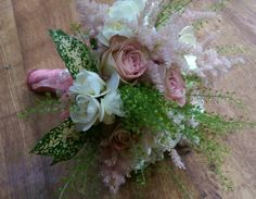 White freesia and vintage rose bridal hand tied wedding bouquet. Designed by Enchanted Florals in glastonbury.