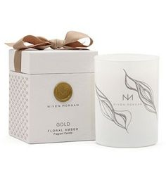 Niven Morgan Gold Candle -Sophisticated and sexy, Niven Morgan's dreamy signature fragrance stirs sweet longings and fond memories with its warm top notes of vanilla and floral amber rising from a bouquet of rich Egyptian neroli and Italian bergamot blended in lusciously subtle aromas of sandalwood and musk. For the sensualist.    Interior Design, Home Decor and Furnishings in Grove, Oklahoma.