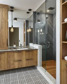 This is a #modernfarmhouse #bathroom with personality & fresh ideas! I am especially loving the #cementtile, the #teak #shower #floor and the slate #chevron #shower #tile. #Countertop is concrete. Design by @squarefootageinc. #Pic: @valeriecox #interior #InteriorDesignPost #interioroftheday #motivation #bathroomremodel #farmhousebathroom #bathroomgoals #bathroomdesign #interiors #mydomained #house #housetours #houzz #HGTV #goals #ighomes Teak Bathroom, Diy Bathroom Vanity, Bathroom Wall Sconces, Bathroom Vanity Lighting, Bathroom Flooring, Bathroom Interior, Bathroom Ideas, Downstairs Cloakroom, Bathroom Inspo