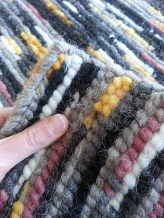 Handcrafted tweed locker hooked rug made from homegrown Navajo Churro wool, in natural and hand-dyed colors. Using the locker hooking method, this rug is thick