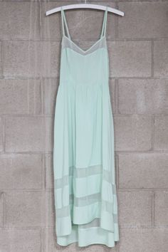 Asymetric lace contrast dress in mint <3 love how delicate it looks, but the blocked out sheer sections give it an edge