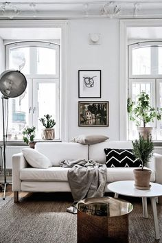 Scandistyle minimal design. Monochrome interior & gorgeous eyebrow-arch windows
