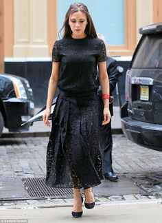 Posh look: Victoria Beckham sported a sweeping semi-sheer dress with intricate lace detailing as she exited her New York hotel on Tuesday