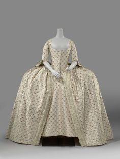 Robe à la française, c. 1780. Cream striped silk, with woven stripes and little floral bouquets, linen lining.
