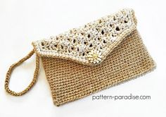 Ravelry: Glamour Clutch pattern by Maria Bittner...I love these little clutches with a strap long enough to put over my head and wear at my side...Free pattern!!