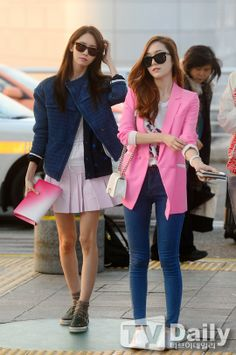 Yoona and jessica airport fashion. Jessica's pink blazer looks casual yet business like at the same time.