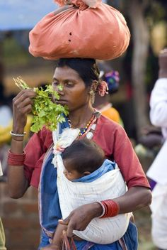 Babywearing and carrying stuff on your head... while shopping! Impressed! Jhalmala market, India by Wietsej.