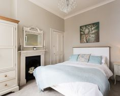 Farrow & Ball Elephant's Breath painted walls in this mid-sized traditional guest bedroom. The Humber with grey walls, carpet, a standard fireplace and a metal fireplace surround. Calming Bedroom Colors, Bedroom Wall Colors, Bedroom Color Schemes, Home Decor Bedroom, Farrow And Ball Bedroom, Grey Carpet Hallway, Elephants Breath, Barn Bedrooms, Living Room Bar